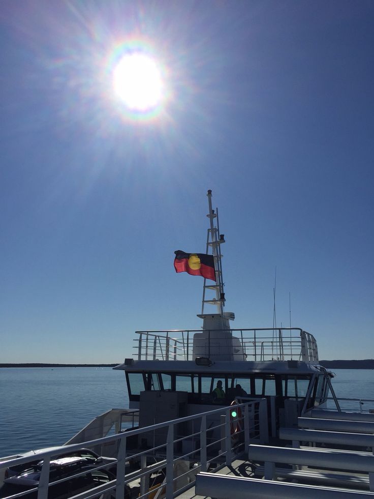 Moreton Bay, on the ferry to North Stradbroke Island QLD AUS Showing the Indigenous flag
