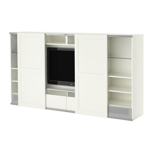 BESTÅ TV storage combo with sliding doors IKEA Sliding doors save space when open and hides the TV when needed.