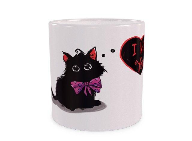 Zobacz jaką piękną kokardkę ma ten kotek, przesłodko wygląda. Oczy wyrażają miłość i wdzięczność do osoby, która mu tę kokardkę założyła ;)