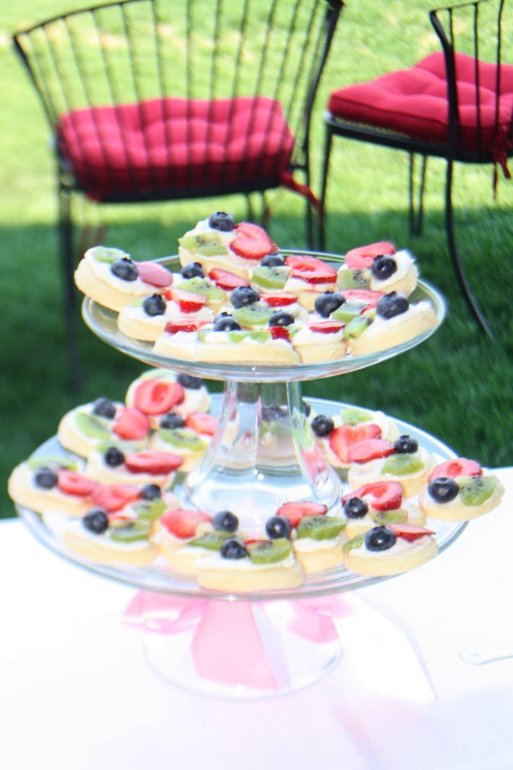 Fruit pizza's - sugar cookie crust, cream cheese icing/cream, and fruit