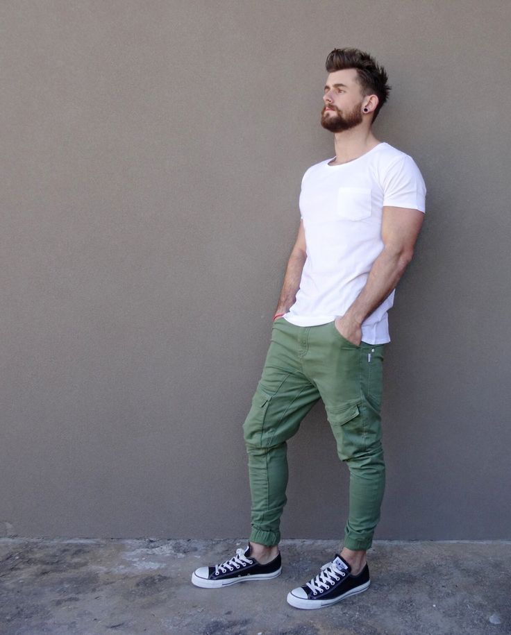 Shop this look on Lookastic: https://lookastic.com/men/looks/white-crew-neck-t-shirt-olive-cargo-pants-black-and-white-low-top-sneakers/11016   — White Crew-neck T-shirt  — Olive Cargo Pants  — Black and White Low Top Sneakers