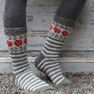 These socks are inspired by old Gotlandic socks with roses and leaves in stranded knitting.