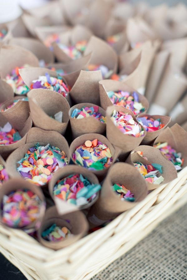 Confetti in cones for party guests. I think this would be fun if the confetti were sparkly...gold or silver. But then I love sparkly everything...