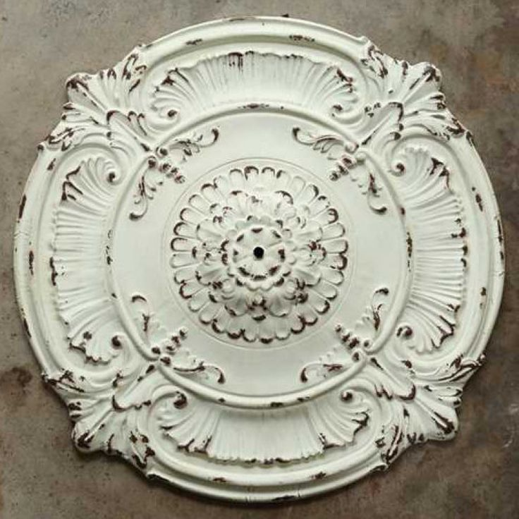 "Our metal chandelier ceiling medallion will make a beautiful statement piece in any farmhouse dining room with its ornate and distressed white finish. Measures 39""Diameter"