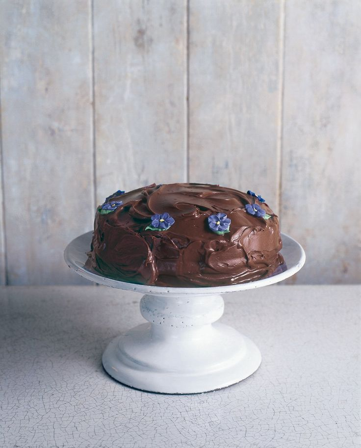"If you're going to get started, this is the cake you should begin with. Not just because it's simple - though it is - but because it is, for me, the essence of chocolate cake: melting, luscious and mood-enhancingly good. A food technologist would explain this in terms of ""mouthfeel"" but I don't know quite how that makes me feel. I often describe this cake as a sort of idealised chocolate cake out of a packet, which doesn't sound so very inviting either. But what I me..."