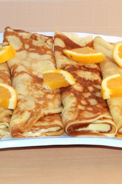 Pandekager med appelsincreme fra Bageglad.dk /// Crepes with orange cream filling
