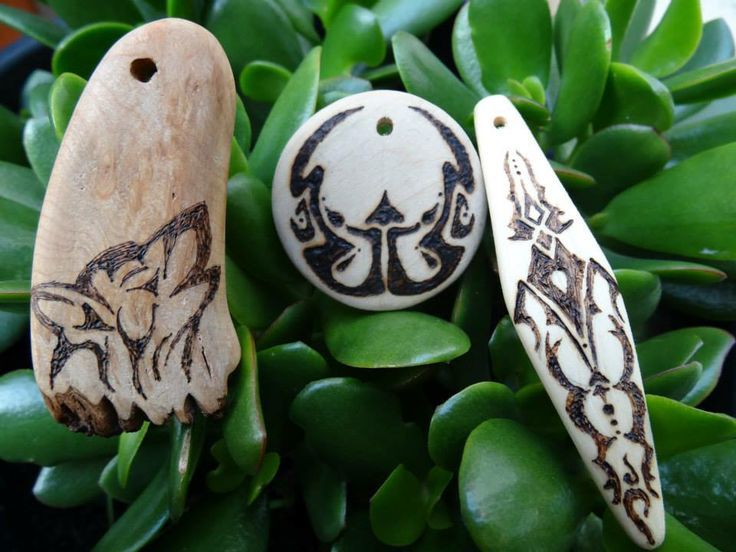 Our first Tribal/Abstract Pendants  Tribal wolf, moon, and diamond