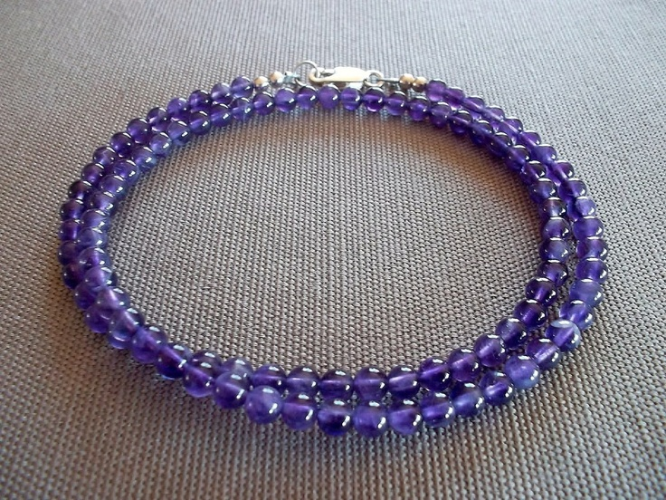 Handcrafted necklace featuring 4mm genuine amethyst beads. 18 inches in length, with a sterling silver clasp.