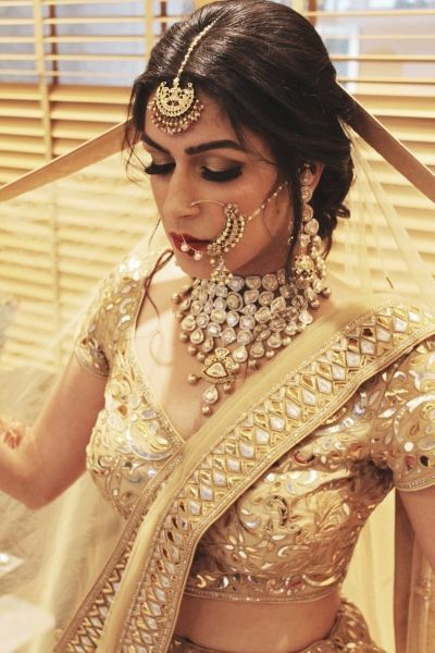 Bridal Details - Bride in a Choker Polki Necklace wiht a Gold Gotta Patti Blouse and Net Dupatta | WedMeGood #wedmegood #indianbride #indianwedding #bridal #weddingjewelry #indianweddingjewelry #gold #polki #indianjewelry