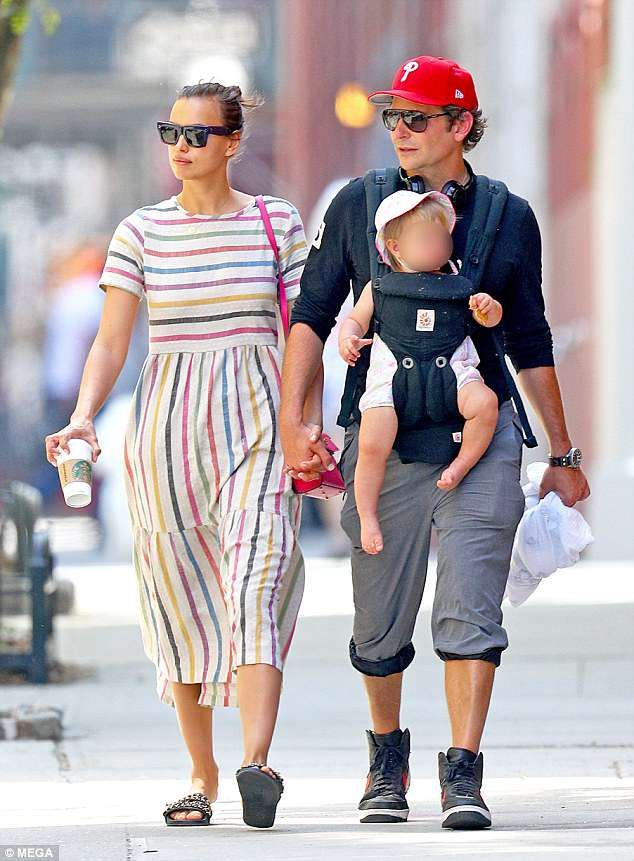 cc9bc0570 Bradley Cooper straps daughter to chest on family outing with Irina ...