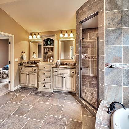 Cambridge II floor plan - beautiful bathroom - master suite - double vanities - tile - walk-in shower - bathtub - decor
