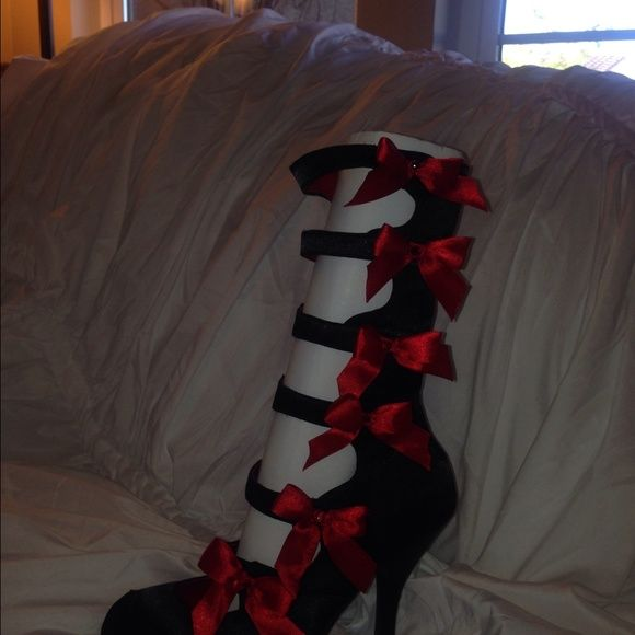 Black satin burlesque strap up heel New still in box. AWESOME fun & sassy!!! Black satin heel that can zip up side or use velcro closure w/ red satin bow w/ sparkle! Size 7. Perfect for Halloween! These will give your costume just the kick it needs  funtasma Shoes Heels