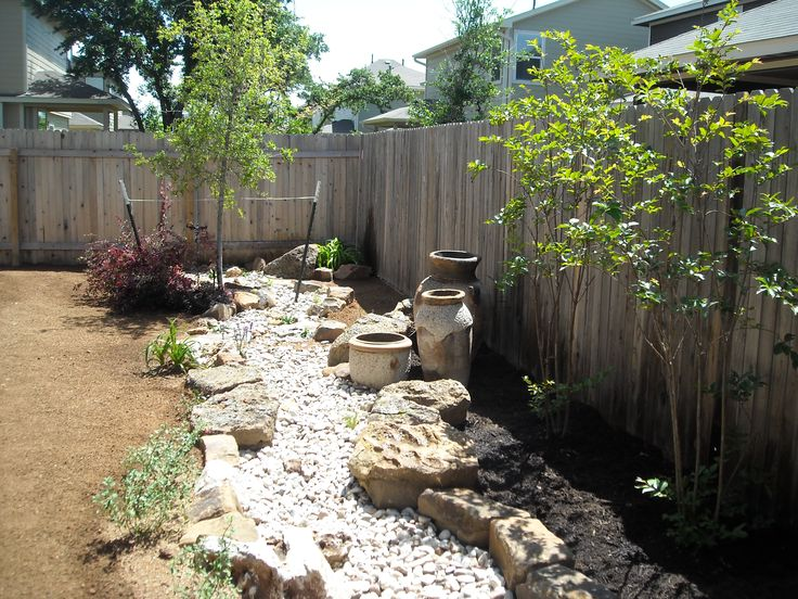 Backyard landscape - dry creek bed with native plantings