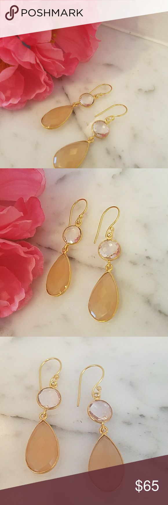 """Stunning Pear Drop Semi precious stone earrings Stunning Pear Drop Semi precious stone earrings. Gold-plated pierced semi-precious stone earrings. Noticed that the circle stone has a hue of purple and the pear shape Stone has a golden hue to it. The earrings drop slightly over 2"""" long. These are new without tags but come in original bag. Jewelry Earrings"""
