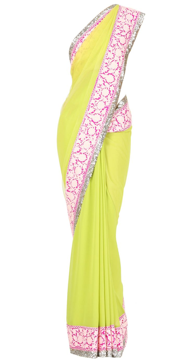 Lime green net and georgette Sari with shocking and pale pink embroidered and sequin border with golu's by MANISH MALHOTRA. Shop at https://www.perniaspopupshop.com/manish-malhotra/manish-malhotra-3429