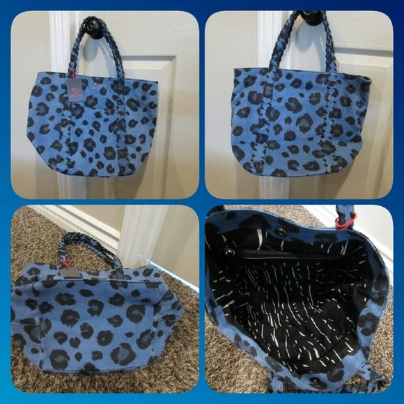 "*SALE**Kelsi Dagger Blue Suede Leopard Handbag New with tags Super Cute Kelsi Dagger Handbag Blue suede with black leopard print All suede and leather 16.5"" W x 8"" D x 12"" H **this bag is new with tags, but has a few minor dirt marks or darkened suede marks...not sure what exactly it is from but i tried to show in the last set of pictures**they are minor though*the inside is perfect**price reflects blemishes**  **this bag is also on mercari for cheaper** Kelsi Dagger Bags"