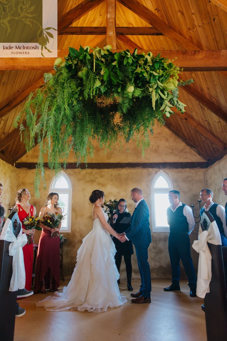 Thinking installations? Don't forget the ceremony - A full, lush chandelier of foliage looks amazing against the stone and timber of Peppers Creek Chapel. www.jademcintoshflowers.com.au euphoriafilms.com.au pepperscreek.com.au