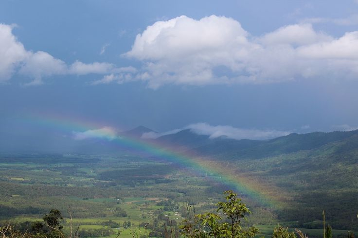 Storms brewing in the distance and a beautiful rainbow. #Eungella #landscape