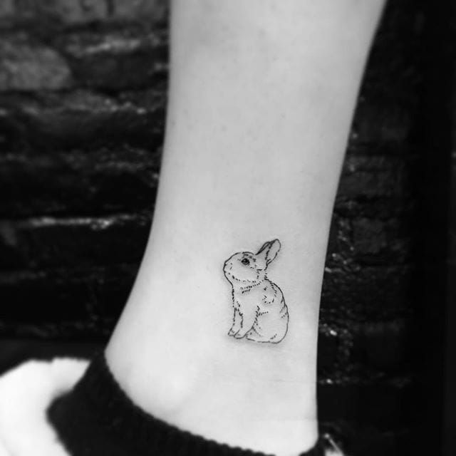 Bunny linework tattoo by Evan