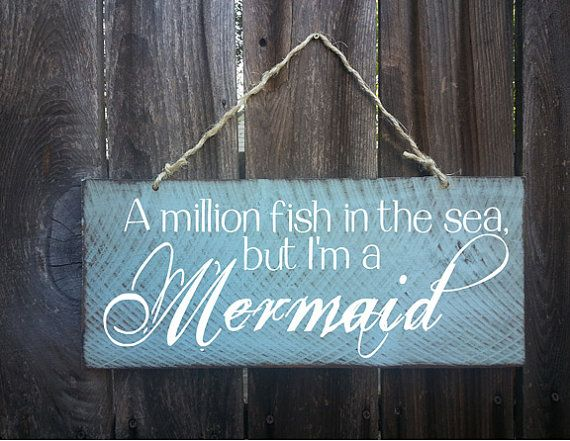 A million fish in the sea but I am a mermaid. Measures 18 wide x 8 tall.    Hand painted with a distressed beach look. Jute Twine hanger on top.