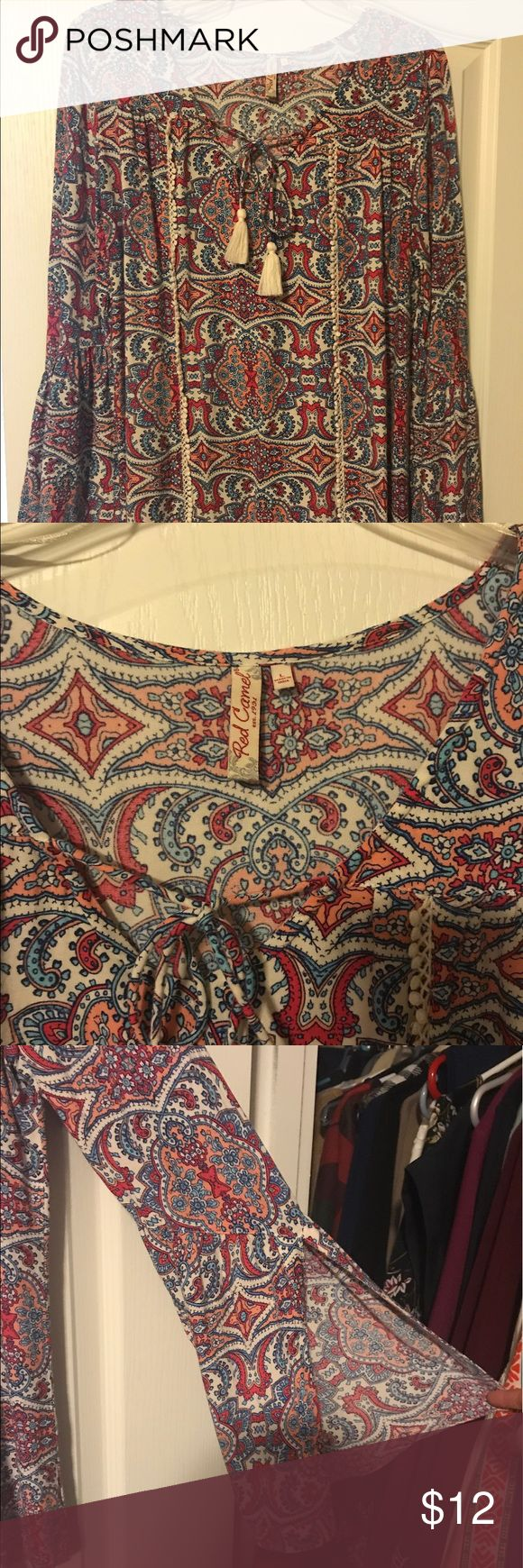 Paisley top with split bell sleeves Cute shirt with bright design. It has a tassel tie at the neck and bell sleeves that are split halfway up. Worn a couple of times, great condition! Red Camel Tops Tees - Long Sleeve