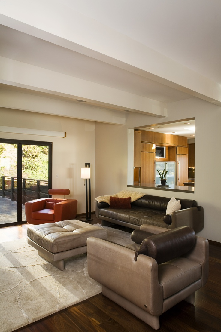 Beams can hang heavy over a living room but the space is instantly lightened by