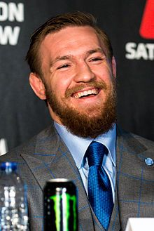 Conor McGregor(1988 - ) in 2015.  UFC 189 World Tour London (2).jpg /// an Irish mixed martial artist who has primarily competed in the featherweight division of the Ultimate Fighting Championship (UFC), and now plans to also fight at lightweight and welterweight. He is the current UFC Featherweight Champion, and the former Cage Warriors Featherweight and Lightweight Champion. As of 7 March 2016 he is No. 8 in official UFC pound-for-pound rankings and ranked as the No. 1 featherweight and…
