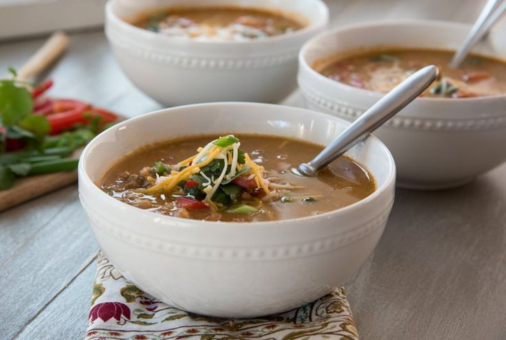 "Trim Train Taco Soup (FP) This THM original soup first appeared in Woman's World (May 9, 2016 edition) titled as ""Secret-Ingredient Weight-Loss Soup"". Even as a FP this soup is deliciously rich. If desired, make it an S by topping with some sour cream and grated cheese. Or make it an E by adding a handful of cooked beans and sprinkling some baked corn chips on top. Top with chopped cilantro and a dollop of Greek yogurt, if desired. www.TrimHealthyMama.com"