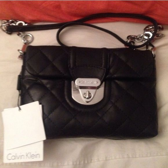 Calvin Klein Quilted Crossbody has signs of wear, not visible in pics but has signs of fading on edges and front flap, comes with original tags. selling for super cheap. Calvin Klein Bags