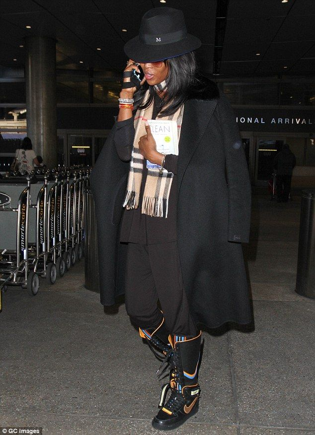 Naomi Campbell injects a spot of fun with a pair of unusual lace-up trainer boots | Daily Mail Online