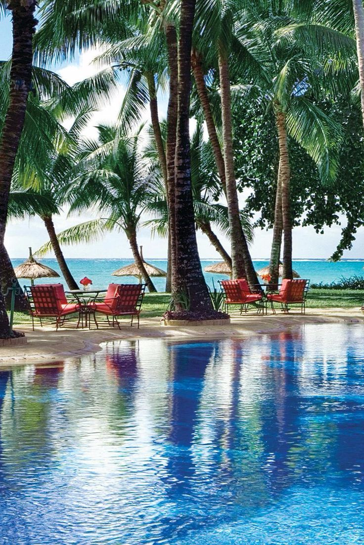Just steps from the beach, the outdoor pool is shaded by towering palm trees. One&Only Le Saint Geran (Mauritius) - Jetsetter