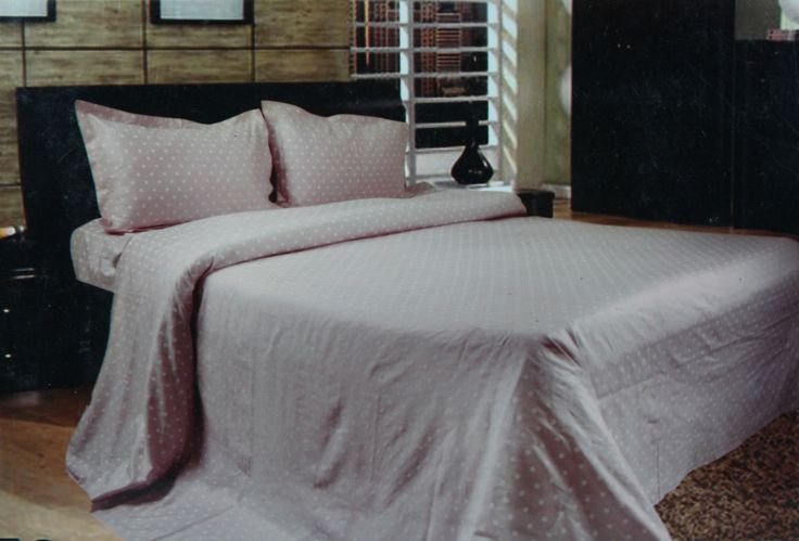 Create a refreshing and soothing ambiance in your bedroom with this luxurious bed linen set-a set of bed sheet with two matching pillow covers. This King Size (275*275cm) bed linen set creates a pampering and luxurious look into any kind of home décor style. The fresh, soft and soothing pink color gives a treat to eyes and mood in all respects. The super fine quality cotton fabric makes it even more easy to use in any season and is absolutely soft to touch.
