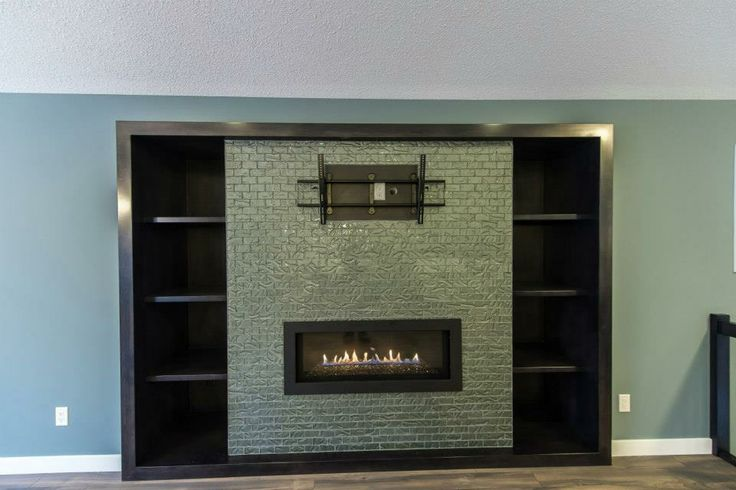 Full wall shelves, full wall tile and TV mount to accompany this in wall fireplace  https://www.facebook.com/media/set/?set=a.552829334799368.1073741863.135706893178283type=3
