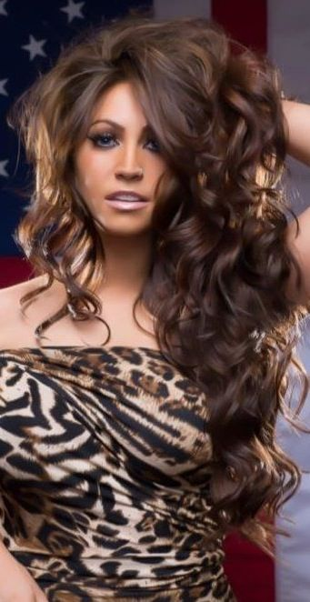 Sexy Curls!! Like the Curly Hair with the  Leopard  Print Top. Very Sexy!