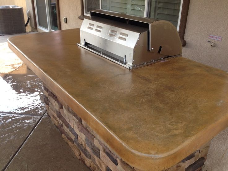 Acid stained concrete countertops with mat finish sealer. Outdoor BBQ island by Lancon Plus and Lagoon Rock Spas-Temecula