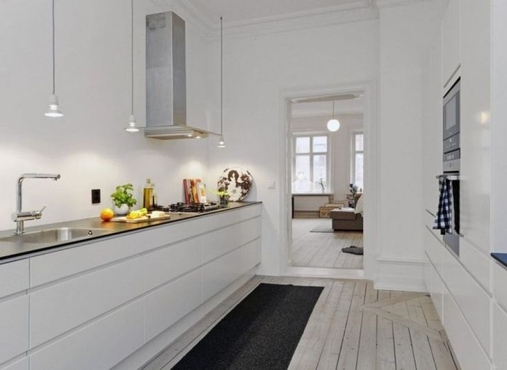 white cabinet with steel table tops and really nice wooden floor