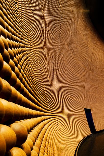 400,000 timber beads make up the acoustic panels in Fusionopolis' Genexis theatre in Singapore, designed by Kisho Kurokawa. This is fabulous.