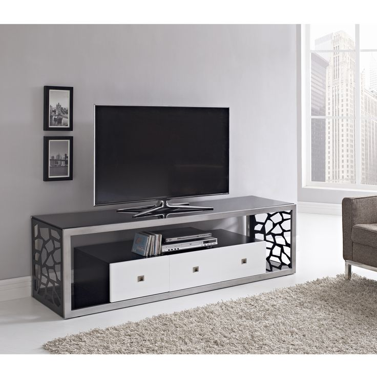 Thick, tempered safety glass in a hand-brushed silver, steel frame with intricate, laser side cutouts in a mosaic design. The accentuated white on three storage drawers offer a unique finish. Vast size, durable construction supports TVs up to 70 inches.