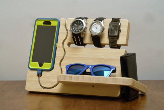 The Watch and Eye dock is minimalistic and a feature rich solution to both charge and display your Iphone 6 or 6 Plus. This Dock/valet has an integrated slot that can keep 3 to 4 watches at the ready. A carved pocket in the base can store eyeglasses, sunglasses, or other items you may carry in your daily life. A slot to the side can securely store a wallet or check book. Additional storage can be found in the rear of the dock for keys or change etc. This dock was designed for an Iphone 6…