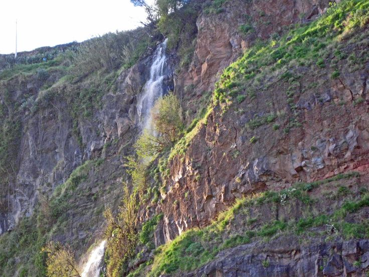 This beautiful, lazy waterfall is located right behind the house. Madeira, Portugal homes for sale.