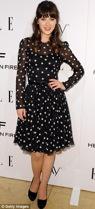 Zooey Deschanel in a black Dolce & Gabbana dress with white polka dots.