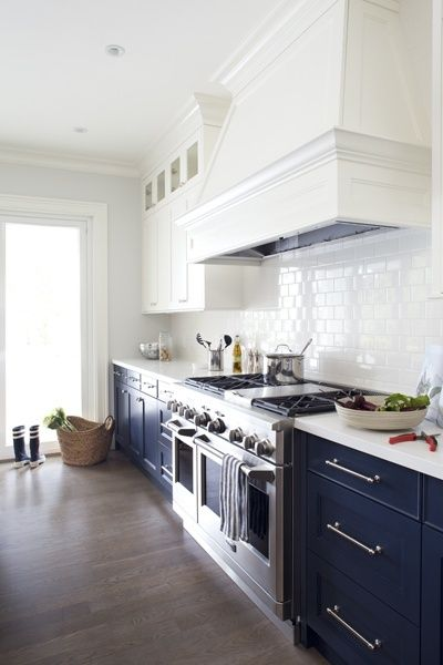 Navy kitchen cabinets White upper cabinets