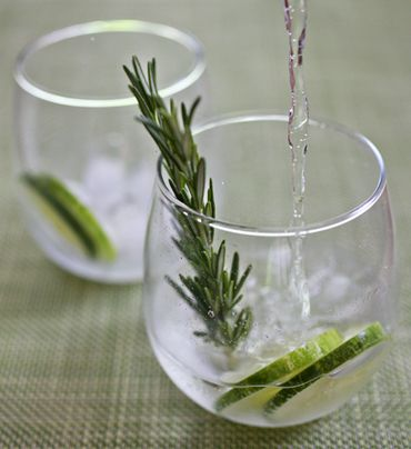 Cucumber-Rosemary Gin and Tonic 1 cucumber1 lime3 sprigs rosemary2 oz. Hendrick's Gin4 oz. tonic water (preferably Q or Fever-Tree)ice