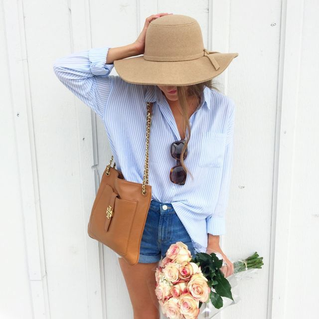 Oversized pinstriped blue button down + high waisted denim shorts + wide brimmed hat
