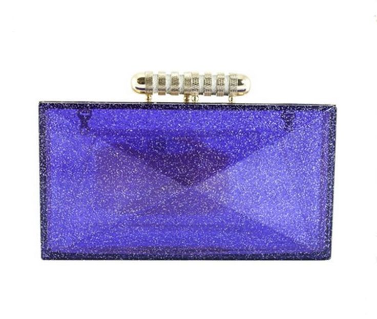 Fun and fashionable purple clutch bag. Made from perspex, slightly see though with glittery detail. Long chain detachable strap for shoulder use.   eBay!