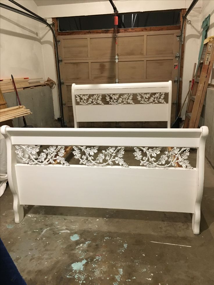 Sleigh Bed painted Navajo White . Distressed and waxed. Wrought Iron cut outs also painted and distressed. Part of cape cod Bedroom set.