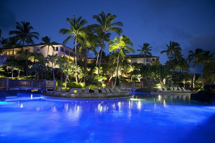 Relax by the pool at Grand Hyatt Kauai Resort  and Spa - day or night, rain or shine.