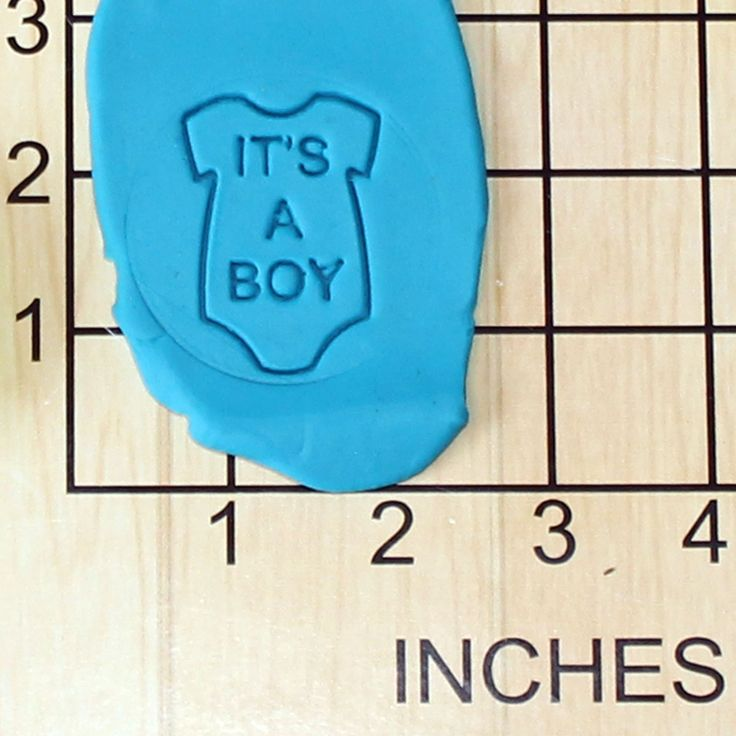 It's A Boy Onesie Shape Cupcake Size Decorating Fondant Stamp and Handle #1452. It's A Boy Onesie Shape Decorating Fondant Stamp with Handle. This 3d printed plastic Stamp makes the shape of a onesie with the words it's a boy in it. A great way to celebrate your new bundle of joy or to use for a gender reveal party. Some uses for this stamps are cookie dough, play doh, or fondant. Actual measurements can be seen in photo. Color of plastic will vary according to availability and may be...