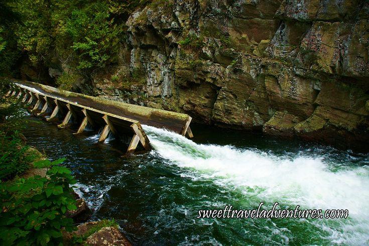 Opening of Hawk Lake Log Chute into River in Haliburton Highlands, Ontario