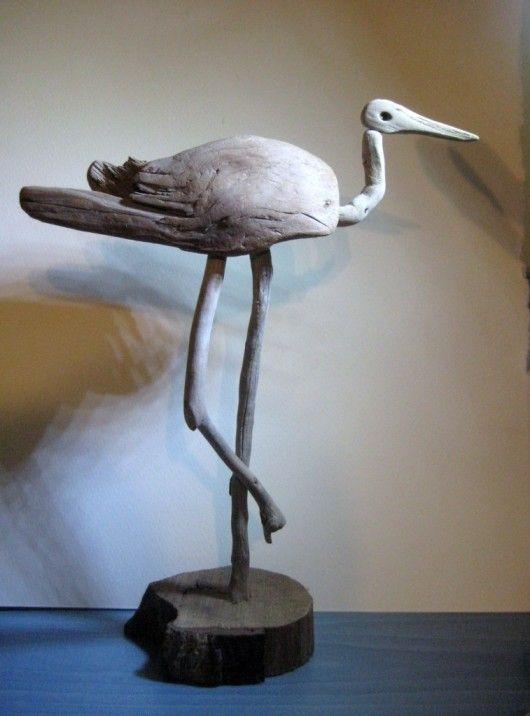 Kind of a primitive looking shore bird.....drift wood sculpture.